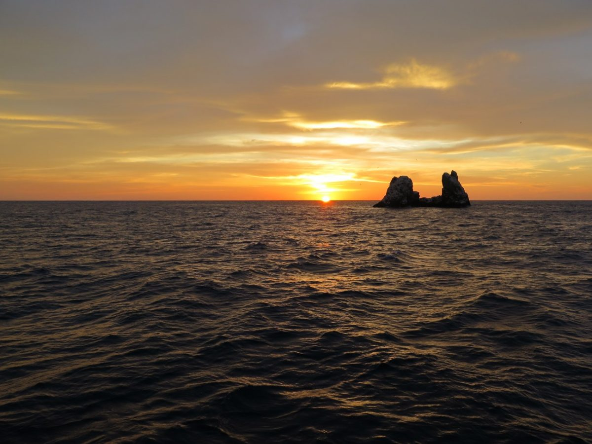 roca partida silhouetted against the glowing sunset