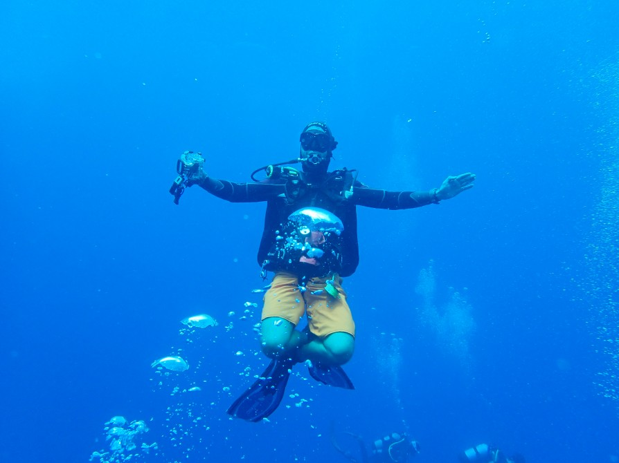 diver poses cross legged for the camera