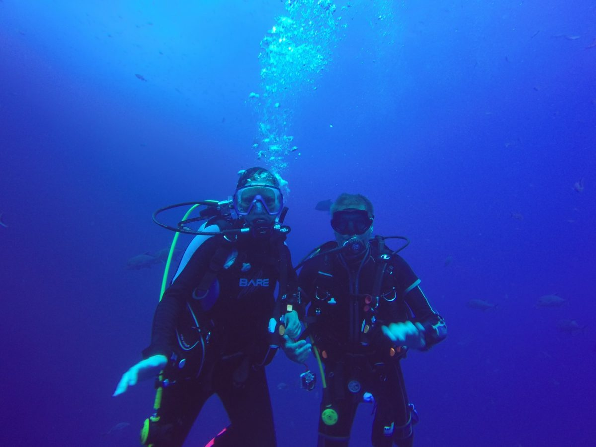 two scuba divers pose for a great underwater phtoo