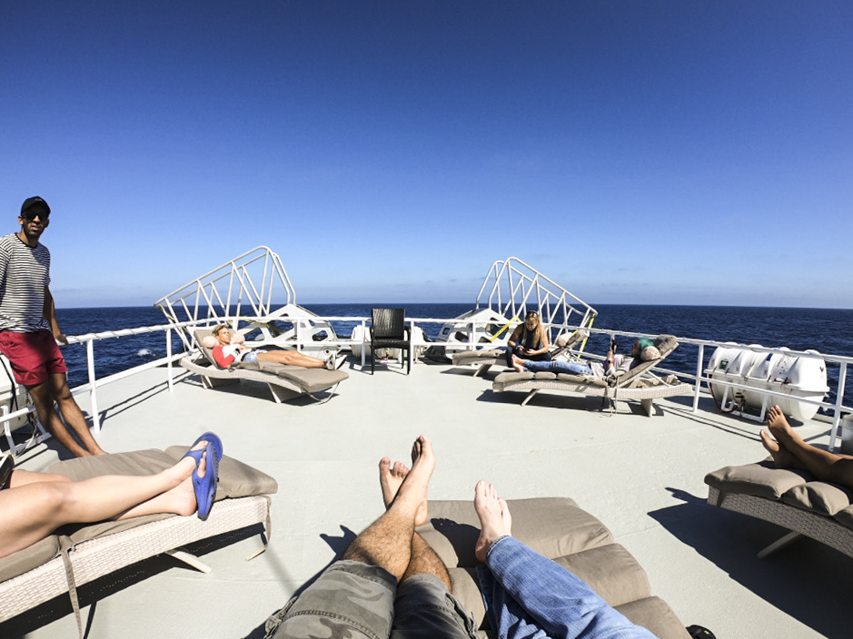 Guests warm up and relax on the sundeck