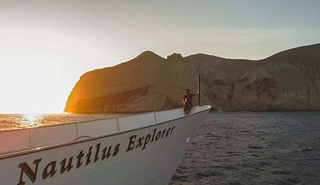 Nautilus explorer sails by san benedicto island's cinder cone